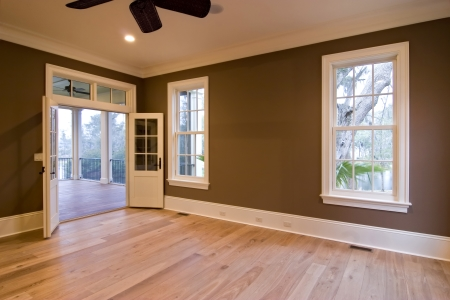 Empty brown room with wood floors